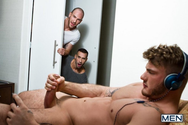 Two men catch another man jacking off