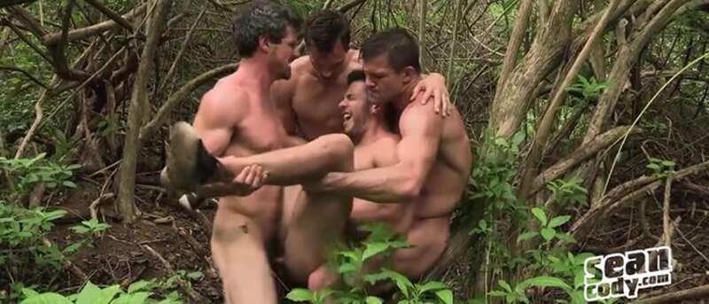 four men having bareback sex in the woods